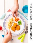 small kid's meal   fish  chips  ... | Shutterstock . vector #1258424113