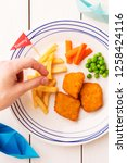 small kid's meal   fish  chips  ... | Shutterstock . vector #1258424116