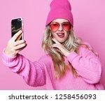 fashion cool girl  taking photo ... | Shutterstock . vector #1258456093