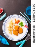 small kid's meal    fried fish  ... | Shutterstock . vector #1258476160