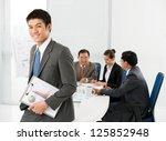 smiling businessman standing... | Shutterstock . vector #125852948