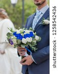 nosegay in hands of bridegroom. ... | Shutterstock . vector #1258542436