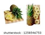 sliced pineapple on chopping... | Shutterstock . vector #1258546753