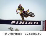 Red Motocross winner jump - stock photo