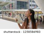 an asian female traveler... | Shutterstock . vector #1258586983