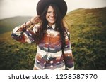 stylish hipster girl in hat... | Shutterstock . vector #1258587970