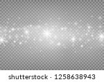 white sparks and silver shiny... | Shutterstock .eps vector #1258638943