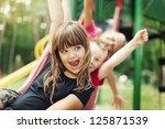 Kids Having Fun On Slide