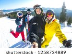friends skiers and snowboarders ... | Shutterstock . vector #1258734889