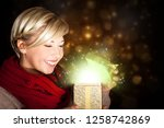 attractive woman opening a... | Shutterstock . vector #1258742869