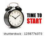 alarm clock and text time to... | Shutterstock . vector #1258776373