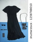 Loose Black Dress On A White...