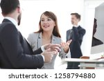 manager and client talking in... | Shutterstock . vector #1258794880
