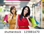 two girlfriends with shopping...   Shutterstock . vector #125881670