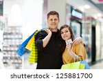 young couple with shopping bags | Shutterstock . vector #125881700