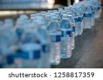 plastic water bottles lined up...   Shutterstock . vector #1258817359