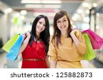 two girlfriends with shopping...   Shutterstock . vector #125882873