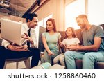 young family consulting with a... | Shutterstock . vector #1258860460