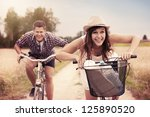 happy couple racing on bikes | Shutterstock . vector #125890520