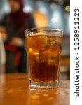 a glass of an iced lemon tea....   Shutterstock . vector #1258911223