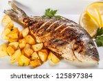 sea bream fish with potato on... | Shutterstock . vector #125897384