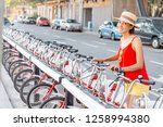 happy woman renting bicycle at... | Shutterstock . vector #1258994380