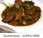 stewed beef with brown sauce in ...