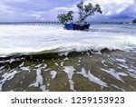 the waves of the sea produce... | Shutterstock . vector #1259153923
