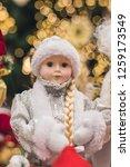 christmas girl dolls  snow...   Shutterstock . vector #1259173549