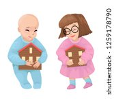 baby boy and girl holds a house ... | Shutterstock .eps vector #1259178790