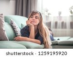 sad disappointed woman lying on ... | Shutterstock . vector #1259195920