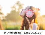beautiful young woman in warm... | Shutterstock . vector #1259202193