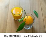 a glass of freshly squeezed... | Shutterstock . vector #1259212789
