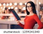 smart woman holding a book in a ... | Shutterstock . vector #1259241340