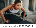 close up of a woman doing... | Shutterstock . vector #1259254519