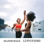 two cheerful women in fitness... | Shutterstock . vector #1259255080