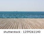 wooden deck waterfront sea... | Shutterstock . vector #1259261140