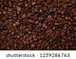 aroma coffee beans background.... | Shutterstock . vector #1259286763