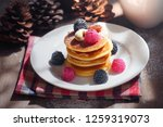pancake topping with berries...   Shutterstock . vector #1259319073