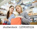 one of shopaholics unpacking... | Shutterstock . vector #1259335126