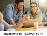 colleagues workshopping... | Shutterstock . vector #1259346349