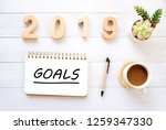 2019 goals on notebook paper at ... | Shutterstock . vector #1259347330