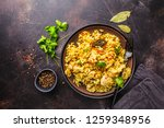 rice with chicken in a black... | Shutterstock . vector #1259348956