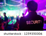 security guard in night club. | Shutterstock . vector #1259350306