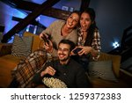 group of best friends sitting... | Shutterstock . vector #1259372383