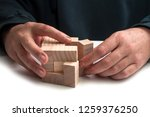 closeup of man hand with wooden ... | Shutterstock . vector #1259376250