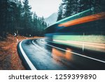 blurred green bus on the road... | Shutterstock . vector #1259399890