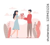 man give a present to a woman... | Shutterstock .eps vector #1259421226