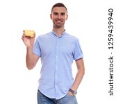handsome man in blue shirt with ... | Shutterstock . vector #1259439940