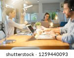 three colleagues in co working... | Shutterstock . vector #1259440093